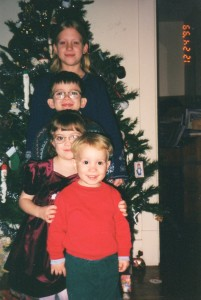 Our four amazing children, whose smiles and laughter pulled us through a very hard winter. Side note: Our house was so tiny, we put up half of our Christmas tree, so it could be flat against the wall.